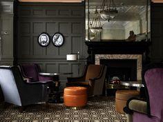 http://www.apartmenttherapy.com/dc/interior-design/designer-spotlight-do-you-know-india-mahdavi-157333?utm_source=feedburner_medium=feed_campaign=Feed%3A+apartmenttherapy%2Fmain+%28Main%29    And interior design by India Mahdavi. Geometric patterned carpet, slate chocolate, and purple chairs. Gray walls.
