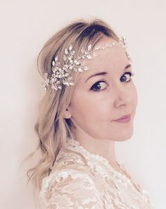 Dewdrop  This beautiful headpiece has been crafted out of silver plated wire and is adorned with an array of sparkling Swarovski crystal beads and stones, and luxurious Swarovski pearls. A satin ribbon tie at the back allows adjustment to fit any head size, alternatively this can be removed easily to allow pinning into any hairstyle.  This piece can be worn around the forehead or in the hair.  All headpieces are wrapped and boxed.