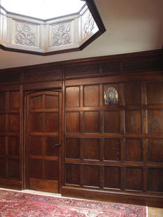 Panelled entrance hall with carved roof lantern.jpg