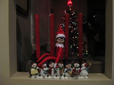 December 4, 2014 ~ Sparky hanging out with our snowmen candle holder.