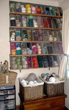 Clever!  Laughing Purple Goldfish Design uses magazine files for yarn storage on shelves. I love the ideal of using book cases for yarn storage.