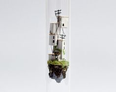 Micromatter by Rosa De Jong: Miniatures in Glass Test Tubes - Garden Decor -        For her series Micro Matter, Amsterdam-based designer and art director Rosa de Jong created towering houses and tall buildings inside the narrow confines of large glass test tubes. Perhaps comparable to a ship in bottle, the little houses and buildings are all handmade using natural...