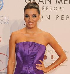 Purple heart: As Eva Longoria made her way into her foundation's charity gala in Marbella, she stunned revelers with her dramatic violet strapless gown with an hour glass-shaped design on the front