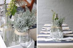 Simple greenery and glass jars used as table decor