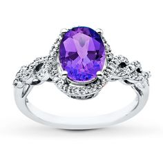 Regal amethyst stands center stage in this gorgeous ring for her. Crafted in lustrous 10K white gold, this ring features a shimmering oval amethyst surrounded by 1/8 carat total weight of sparkling diamonds. Diamond Total Carat Weight may range from .115 - .14 carats.  Gently clean by rinsing in warm water and drying with a soft cloth.