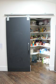 chalkboard barn door -- could we put 2 smallish ones over the front window, instead of curtains, to slide out to the sides for the kids to use?