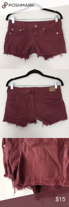 AEO Boho Cutoff Shorts Selling a super cute American Eagle Outfitters brand cutoff shorts.  Size 4 with stretch.  Nice deep maroon color with silver hardware/buttons.  5 pocket style with signature brown AEO tag logo on back.  Worn gently and in excellent condition.  Great for boho looks and pairs well with white tops.  Perfect for summer! American Eagle Outfitters Shorts Jean Shorts