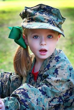 Our children will take pictures in daddy's covers. Love the USMC uniform!