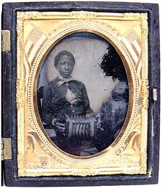 African-American boy with a German concertina: ca. 1861–65