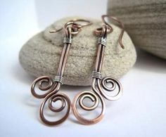 copper wire jewelry ideas | Copper and sterling silver earrings with spirals and wraps