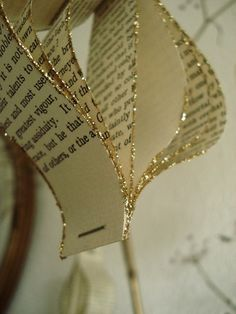 Pages from old book...staples/ribbon/glue and glitter