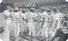 August 13th, 1979…Lou Brock is congratulated by Cardinal teammates at Busch Stadium after hitting a single off Cub's pitcher Dennis Lamp for his 3,000th career hit.