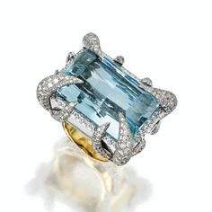 AQUAMARINE AND DIAMOND RING, TONY DUQUETTE. The rectangular mixed-cut aquamarine weighing approximately 55.00 carats, held within claws pavé-set with round diamonds weighing approximately 6.65 carats, mounted in 18 karat white and yellow gold, size 7, signed Tony.