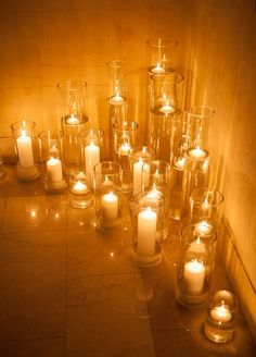 Lots of candles light up the hall way. So simple but so stunning!