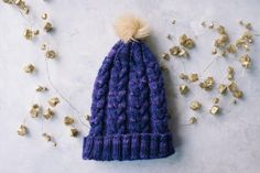 Whether youre just learning how to cable or have been cabling since before you can remember, the Purple Haze Knit Hat is a nice, easy cabled hat pattern that will suit anyone. Easy Knit Hat, Cable Knit Hat, Knitted Hats, Cable Knitting Patterns, Knit Patterns, Free Knitting, Sewing Patterns, Purple Haze, Knit Or Crochet