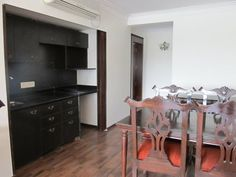 Kitchen-Dining area in an Apartment at #Bradburry. #OIADesign #Pune #hotels