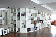 Beautiful Bookcase Apartment in Brazil by Triptyque Studio