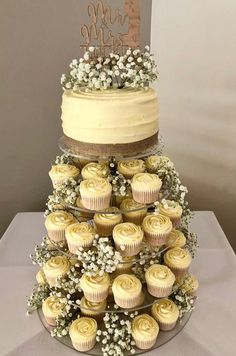 Eschew the traditional wedding cake in flavour of a quirky cupcake tower wedding cakes with cupcakes 20 wedding cupcake tower ideas for your big day Cupcake Tower Wedding, Wedding Cakes With Cupcakes, Cupcake Cakes, Big Cupcake, Rustic Cupcakes, Wedding Shower Cupcakes, Cupcake Tier, Pastel Cupcakes, Different Wedding Cakes