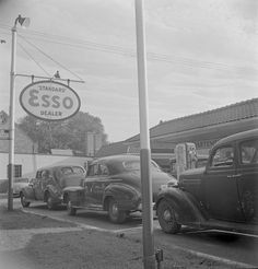Washington, D.C. On morning of July 21st, the last day before stricter gas rationing went into effect, cars were parked in front of gas stations long before they opened, waiting to fill their tanks on the quota of their old ration cards. Cars were parked and left without their drivers who returned at eight o'clock when the station on upper Wisconsin Avenue near the District line opened