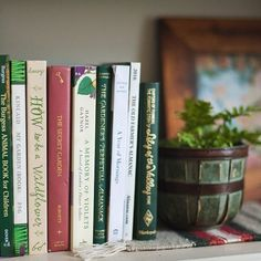 It's no secret of my love affair with my bookshelf. Not only is it completely filled with wonderful stories, but I enjoy spending time arranging it to look aesthetically pleasing. This is one of my favorite sections. A beautiful print by a photographer who's work I enjoy, gardening or nature loving books (I'm an avid gardener), and stories with comparably pretty titles that make this spot what it is. What's your favorite spot on your shelf? #theardentbiblioreads #februaryphotochallenge…