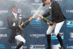 Let's pop the champagne! Daniel Deusser and Daniel Bluman at the stage after the Longines Global Champions Tour Grand Prix in Chantilly.