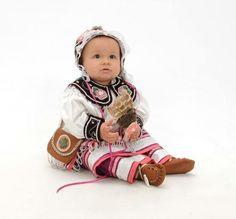 Little Seneca girl in traditional Native American regalia.
