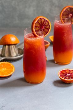 This Winter Tequila Sunrise cocktail will transport you away from the cold and snow. Made with fresh blood orange and tangerine juice, it's a fresh take on a classic cocktail! Winter Cocktails, Fruity Cocktails, Classic Cocktails, Cocktail Drinks, Cocktail Recipes, Drink Recipes, Fireball Recipes, Margarita Recipes, Cocktail Tequila