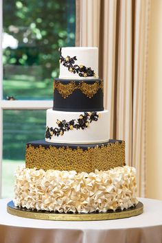 Black, gold and white art deco wedding cake with texture   Creative Cakes   Wedding Guide Chicago