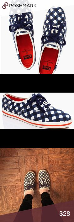 Kate Spade x Keds sneakers (first edition!) These are from the first kate spade x keds collaboration in 2013. Navy and white checkered pattern cotton canvas material with spade logo on the back. Orange stripe detail on the sides of the soles. They have a worn look but have stayed in my closet for a couple years. Easy to clean! kate spade Shoes Sneakers