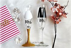 Bride and Groom Champagne Flutes - a perfect wedding gift that is fully custom designed. ♥ ♥ ♥ ♥ Product Details / Dimensions: ♥ ♥ ♥ ♥ (2) 6oz Champagne Flutes- Glitter Fully Sealed & Design is made with Strong Vinyl that will stay in tact with proper care. ♥ Item Care ♥ Not Dishwasher/Microwave Safe. For best and long lasting use, gentle hand washing (and not to scrub/soak the design - Glitter is delicate) is highly recommended to preserve the wine glass. Air drying is best for...