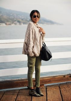 Green pants Cream chunky sweater Ankle booties