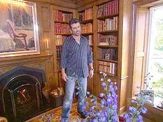 """Next up, George shows off the library. """"It wasn't here when we bought [the house], but I think every house should have a library,"""" he says. """"I'd love to tell you that all the books in this library were Shakespeare or Wordsworth, but most of them are just antique books that we bought in bulk. But I think they're just beautiful, so they're kind of furniture rather than cultural input."""""""