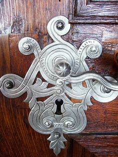 Intricate work ~ beautiful door lever and key hole