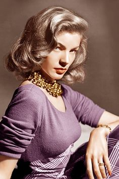 Lauren Bacall color photo print ad portrait movie star glam 40s era knit purple dress plaid hair necklace vintage fashion style to early 50s