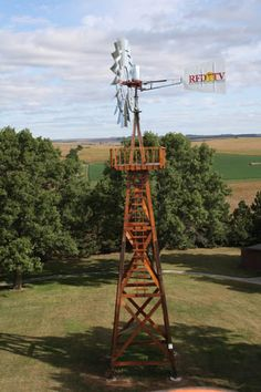 Wood Windmill projects, post and beam other structures by Sand Creek Post & Beam. View this gallery for ideas on Wood Tower Windmills. Windmill Water Pump, Wooden Windmill, Westerns, Beam Structure, Old Windmills, Farmhouse Landscaping, Country Paintings, Post And Beam, Farms Living