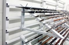 I like this. Could be retrofitted to our exisiting: Artifact Wall Storage - Canadian War Museum Static Shelving Cantilever