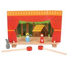 Un petit théatre magnétique avec 4 décors et 15 petits personnages de contes en bois  de la marque Bigjigs. A partir de 3 ans+