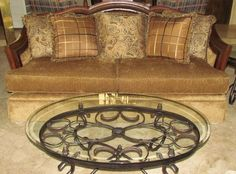 Beautiful Custom Chenille Upholstered Craft Master Estate Collection Sofa with Leather & Wood Trim shown with Custom made Pillows and Wrought Iron Bevel Glass Top Round Cocktail Table