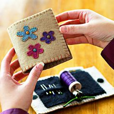 Keep a spool of thread, needles, and pins safe at hand in this  embellished wool take-along.