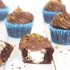 Soft and fluffy chocolate cupcakes with a marshmallow filling, topped with a creamy chocolate buttercream.