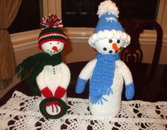 Heres both of the snow people I crocheted, slip them over coffee creamer bottles