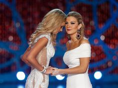 Miss New York, Mallory Hagan, right, reacts with Miss South Carolina Ali Rogers as she is crowned Miss America 2013 on Saturday, Jan. 12, 2013, in Las Vegas