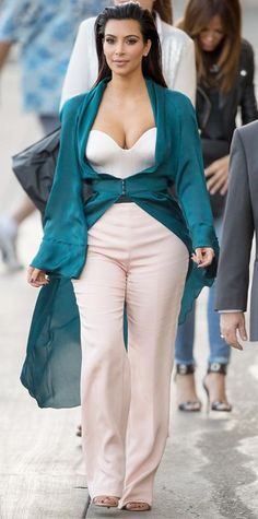 Look of the Day › August 5, 2014 Leave it to Kim Kardashian to wear couture to a Jimmy Kimmel Live show. She wore a white-and-blush two-toned bustier jumpsuit and a silk teal coat (that she buttoned at the waist) from the Ulyana Sergeenko Couture spring/summer 2014 collection.