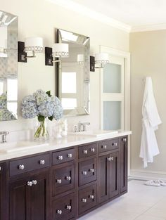 bathrooms - Sherwin Williams - Wool Skein - Pottery Barn Beveled Mirror Stonegate Designs Astoria Sconce tan walls espresso bathroom double vanity cabinets silestone quartz countertops double sinks tan walls frosted glass door