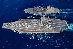 including US aircraft carrier cost, Nimitz-class aircraft carriers, Russian aircraft carrier and US Navy aircraft carrier size. Us Navy Aircraft, Navy Aircraft Carrier, New Aircraft, Aircraft Engine, Military Aircraft, Navy Carriers, Uss Nimitz, Us Navy Ships, Aircraft Painting