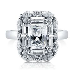 $75 This halo art deco ring is made of rhodium plated fine 925 sterling silver. Features 1.74 carat emerald cut cubic zirconia (8mm x 6mm) in 4-prong setting. Accented with 1.3 ct.tw multi-shape cut clear and round cut clear cubic zirconia in prong and pave setting. Band measures 2.25mm in width.