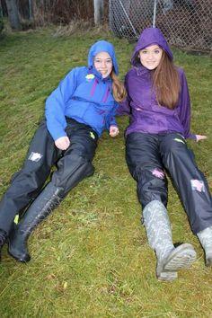 Two girls in rain jackets pants rubber boots Vinyl Raincoat, Pvc Raincoat, Girl In Rain, Nylons, Wellies Rain Boots, Plastic Pants, Rain Gear, Crew Clothing, Nylon Stockings