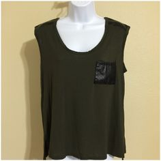 """Green And Black High Low Top Size L • Green With Black Faux Leather Patch Pocket And Shoulders • High Low Design • Soft And Stretch Material Polyester Spandex Blend • 36"""" Bust • 24"""" Length In Back • 16"""" Shoulder Width • 16"""" Length In Front Measured From Center Of Top one clothing Tops Blouses"""