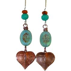 Long Bohemian Style Turquoise And Copper Feather Earrings Long and Bohemian, these Native American-inspired earrings have a wonderful color palette of turquoise, and copper with a splash of silver. featuring a beautiful oval czech glass bead, and copper leaf feather with sterling silver and czech glass ear wires.  - 14x10mm Czech Glass Caribbean Blue Oval w/ Star Window - 17x16mm Classic Nouveau Leaf - 6mm turquoise czech glass roundel - 4mm copper czech glass roundel