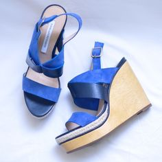 DVF wedges Cobalt blue suede, black genuine leather, wood wedge, and a woven espadrilles part on the platform. Brand new and never worn outside, these look brand new. Adjustable sling back strap. Tagged Size 7 but run small. There just a tad too small for me to wear comfortably best for a 6.5. The quality on these shoes is amazing.    ✭ open to offers  ✭ no Paypal  ✭ good vibes only Diane von Furstenberg Shoes Wedges